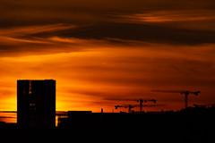 Sunset in Keilaniemi (Topolino70) Tags: canon600d sunset red sky yellow fiery crane building city keilaniemi espoo finland