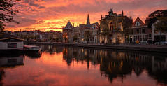 Haarlem on fire (reinaroundtheglobe) Tags: haarlem spaarnestad noordholland netherlands nederland dutch waterfront river water waterreflections reflections city cityscape teylersmuseum sunset fireinthesky spaarne buildings canalhouses historicalcity historicalbuilding
