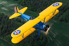 N5222 (hepic.se) Tags: boeing stearman model 75 kaydet yellow blue sweden flying low slow freedom summer biplane trainer classic vintage engine radial lycoming transportation transport topview topside twoseater trees travel usa usaac usaaf icon old open pilot plane wooden propeller aircraft airtoair airplane aviation airforce air aviator airborne aeroplane sky grass ground green joy cockpit colours colourful veteran stockholm countryside