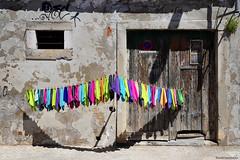 Cleaning cloths - Paños de limpieza (ricardocarmonafdez) Tags: bayetas pañosdelimpieza cleaningcloths sunlight shadows light puertas ventanas windows doors composition colors contrast contraste ciudad city details urban urbanscape streetphotography nikon d850 24120f4gvr