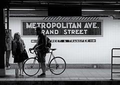 Subway Platform Chat (soboy5) Tags: candid subway subwaystation platform bicycle nyc brooklyn williamsburg bw blackandwhite mono monochrome streetphotography newyorkcity people framing fuji xt1 tiles subwaytile trainstation sign signs