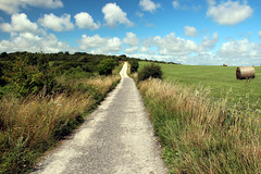 The South Downs Way (iwys) Tags: south downs way sussex chalk footpath alfriston hayrolls grass clouds summer landscape hay bale road lane cotton wool
