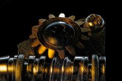 Gears at work in low key- HMM (Peeb is OK) Tags: macromondays cogwheel cogwheels cog wheel tuner machinehead ukelele stilllife
