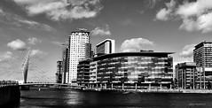 Black & White Broadcast (Glenn Shepherd) Tags: manc bnw bw manchester buildings water skies