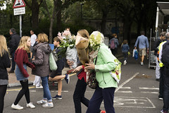 Flower faces (jamiethompson01) Tags: columbia road market flower people workers street sunflowers rain sun bethnal green vinyl vintage zeiss 55mm 18f 2018 uk london fun united kingdom east end plants buy sell bank holiday weekend sunday groups trip chilli peppers bulbs