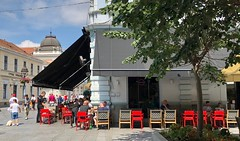 Serbia (Belgrade) Outdoor cafe in the nice pedestrian zone (ustung) Tags: cityview tables redchair outdoor cafe pedestrianzone street belgrade serbia