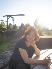 Jeannette, Lisse 2018: Cheeky smile (mdiepraam (30 mln views!)) Tags: jeannette lisse 2018 huysdever portrait pretty beautiful gorgeous attractive elegant classy dutch fiftysomething redhead woman lady milf naturalglamour smile backlight bluetop sunglasses denim jeans