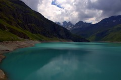 Emerald waters of Alpine Lake Moiry (mark.paradox) Tags: switzerland valais moirylake water colors landscape view nature turquoise emerald blue sky clouds mountains beauty travel trip adventure hike europe reflection