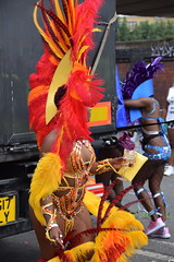 DSC_8291 Notting Hill Caribbean Carnival London Exotic Colourful Orange and Yellow Costume with Ostrich Feather Headdress Girls Dancing Showgirl Performers Aug 27 2018 Stunning Ladies (photographer695) Tags: notting hill caribbean carnival london exotic colourful costume girls dancing showgirl performers aug 27 2018 stunning ladies orange yellow with ostrich feather headdress