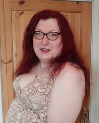 Multi patterned dress semi close up2 (dianne66uk) Tags: transwoman heels hosiery redhair glasses