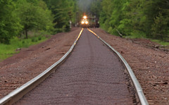 Follow the pellet lined road (GLC 392) Tags: buffalo road crossing eagle mills mi michigan negaunee railroad railway train 3073 3074 lsi lake superior ishpeming iron ore rail distance up close zoom out focus pine tree trees