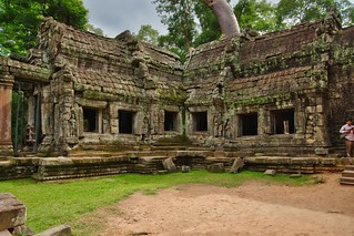 Ruins of Ta Prohm (a.k.a. jungle temple) overgrown with tree in Angkor Archeological Park near Siem Reap, Cambodia