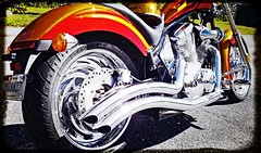Custom exhaust pipes on a tricked out Honda motorcycle (delmarvausa) Tags: orange motorcycle hondamotorcycles chrome custom orangepaint thecolororange custombike motorcycles custommotorcycle custompaint bike motorcycleart wheel wheels honda hondamotorcycle