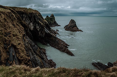 Along the rugged coastline (*M.*) Tags: wales coast sea caves rugged cloudy coastline landscape
