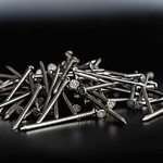 Close up on a Pile of Nails on the Black Background thumbnail