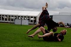 Wrestling Cartwheel (FotoFling Scotland) Tags: cartwheel dunoon kilt wrestler wrestling cowal