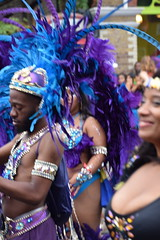 DSC_8395 Notting Hill Caribbean Carnival London Exotic Colourful Blue and Purple Costume with Ostrich Feather Headdress Girls Dancing Showgirl Performers Aug 27 2018 Stunning Ladies (photographer695) Tags: notting hill caribbean carnival london exotic colourful costume girls dancing showgirl performers aug 27 2018 stunning ladies blue purple with ostrich feather headdress