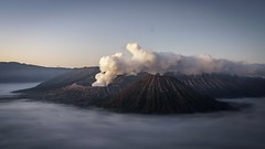 Mt Bromo in the Sea Of Clouds. (ronang) Tags: bromo mount batok sunrise clouds sea mist morning warm yellow volcano active smoking java indonesia landscape timelapse time lapse