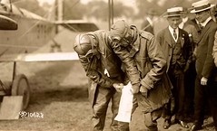 Maj. Fleet helping Lt. Boyle insert map in pant leg holder for return trip to Philly - May 15, 1918 NARA111-SC-010628-ac (SSAVE over 12 MILLION views THX) Tags: airmail usps unitedstatespostalservice may151918 potomacpark pologrounds washingtondc 1918 curtissjn4 aircraft airplane