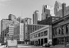 LOOKING DOWN 4TH STREET- (panache2620) Tags: monochrome blackandwhite skyline cityscape candid sidestreet minneapolis minnesota downtown eos canon buildings oldandnew street linear texture simple