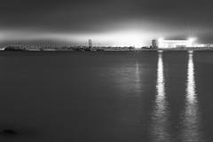 Nous vous devons plus que la lumière... (flotographe13) Tags: bw nightscape nightphoto industry factory light sea seascape electricity