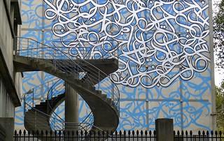 Double helix stairs, Paris University. Institut du Monde Arab in the back.