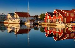 Skudeneshavn in September, Norway (Vest der ute) Tags: xt20 norway rogaland karmøy sea water seaside houses boathouse boat boats reflections mirror evening sailboat tree sky bluesky serene fav25 fav200