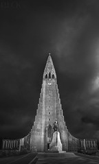 Hallgrímskirkja in Reykjavik, Iceland (Russell Eck) Tags: hallgrímskirkja reykjavik iceland church travel russell eck architecture blackandwhite black white monochrome tower sky building clock