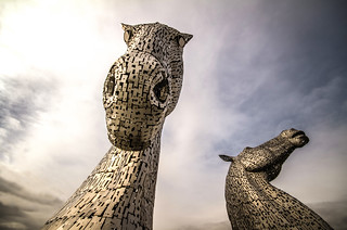 fine art colour - the majestic Kelpies, horse heads towering under a moody Scottish sky, Falkirk, Scotland, UK