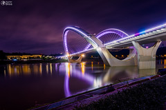Nanning, China Bridge into Night Time Landscape Long Exposure (HunterBliss) Tags: architecture area asia asian background blue bridge building business capital center china chinese city cityscape country design downtown evening famous garden guangxi lake landmark landscape lian light modern monument nan nanning nature night office park people reflection scene sky skyline skyscraper square statue tourism tourist tower travel urban view water