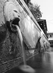 Spili Fountain - Crète (Boutillier Geoffrey) Tags: moment travel voyage ouverture nd longue coule ciel arts ancien pierre animaux animals photographie art spili place leica 818 panasonic gx7 filtre nd1000 water eau europe grèce crète white black bw nb fountain fontaine lion