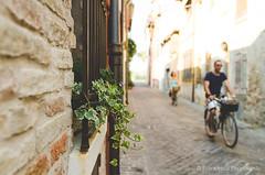Biking in the alley (ciccioetneo) Tags: rimini emiliaromagna romagna italia italy ciccioetneo estate summer rivieraromagnola nikond7000 nikon2470mm28
