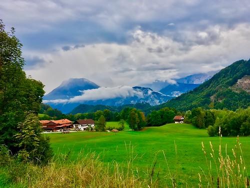 Landscape with mountains and rain clouds in Breitenau near Kiefersfelden, Bavaria, Germany