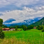 Landscape with mountains and rain clouds in Breitenau near Kiefersfelden, Bavaria, Germany thumbnail