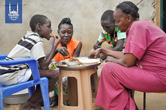 A family enjoying a meal made with Qurbani meat in South Sudan