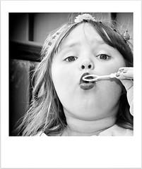 Blowing Bubbles (Missy Jussy) Tags: girl child blowingbubbles portrait mono monochrome blackwhite blackandwhite bw canon 1855mmf5736 canoneos600d manchester candid