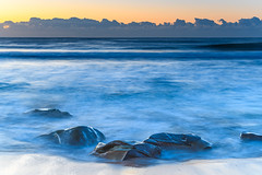 Soft and Rocky Sunrise by the Sea (Merrillie) Tags: daybreak sunrise coastal nature water centralcoast morning sea bluesky macmasters newsouthwales rocks earlymorning nsw landscape australia ocean scenic waterscape waves blueskies macmastersbeach outdoors seascape dawn coast sky seaside