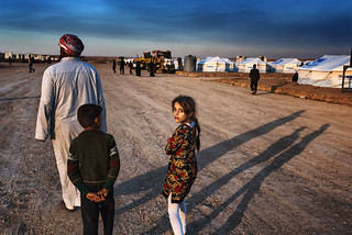 The girl with flowers: refugee camp Iraq