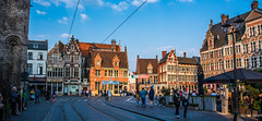 2018 - Belgium - Gent - Afternoon Sun (Ted's photos - For Me & You) Tags: 2018 belgium cropped ghent nikon nikond750 nikonfx tedmcgrath tedsphotos vignetting streetscene street wideangle widescreen tracks traintracks people peopleandpaths pathsandpeople bluesky blue umbrella cafe sidewalkcafe stveerleplein square