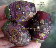 Rocks Grape Wine Vitraux (Laura Blanck Openstudio) Tags: openstudio openstudiobeads glass handmade murano lampwork beads set jewelry rocks nuggets pebbles stones whimsical funky odd colorful multicolor abstract asymmetric earthy organic sterling silver silvered fine arts art artist artisan made usa violet purple grape eggplant plum mauve lilac lavender ocher brown red maroon coral burgundy wine bordeaux matte ethced fuchsia orquid frosted opaque glow glowing green pistachio copper yellow kaleidoscope mosaic vitraux relics
