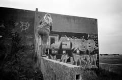 Peterborough treks (esmeelily) Tags: 35mm film analog lomo lomography grain ilford black white is dead urbex derelict abandoned building raf upwood graffiti spraypaint street art vandalism tag tagging olympus trip af 50