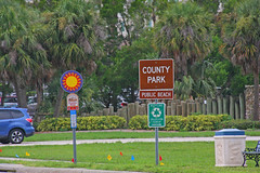 Entrance to Sand Key Park, Clearwater, Florida, (2 of 2 ) (gg1electrice60) Tags: sandkey sandkeypark park beach shoreline gulfofmexico barrierisland sandbar intercoastalwaterway clearwatercommunitysailingcenter sailingcenter clearwater florida fl unitedstates usa us pinellascounty america gulfboulevard gulfblvd parkentrance nearfirestation44 1001gulfboulevard 1001gulfblvd countyroad183 cr183 countyrd183 stateroad699 sr699 staterd699 floridaroad699 signs streetsigns bench car trashbin logfence trolleystopsign tracklessstrolleysign recyclingsign sunsign countypark publicbeach parkinglot