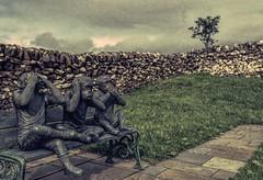 Three Wise Monkeys (Tracey Rennie) Tags: ardnamurchan 52weekchallenge seenoevilhearnoevilspeaknoevil threewisemonkeys texture hss bench sculpture bronze tree