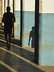 La Habana Vieja (RobertLx) Tags: people man shadow column arcade havana cuba island caribbean architecture city lahabanavieja oldhavana street walking lines contrast