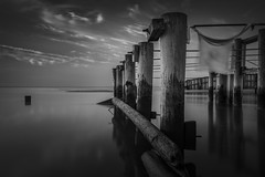 Blowin in the Wind (Thomas Pohlig) Tags: beach seashore seascape landscape series sand water pilings pier clouds jersey jerseyshore newjersey blackandwhite blackandwhitephotography monochrome mono fineart