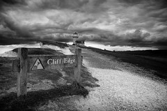 Cliff Edge (Graham Hodgetts) Tags: eastbourne fujifilm fujinon landscape ramble seaford sevensisters southdowns thesouthdownsway walk xf1855mmf2840r sussex xt1 belletout lighthouse sign cloud travel path whitecliffs blackandwhite monochrome