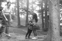 Child's Hug (PB1_1315) (Param-Roving-Photog) Tags: children kids embracing hugging love joy excitement candid photography woods trees deodar forest friends naldehra himachal monochrome blackandwhite bw