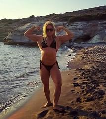 Sunset at Triades Beach Milos (Madam Mysteria) Tags: greece milosisland sunset beach biceps abs legs muscle bikini mysteria