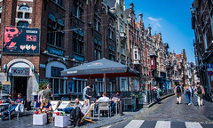2018 - Belgium - Gent - On the Street (Ted's photos - For Me & You) Tags: 2018 belgium cropped ghent nikon nikond750 nikonfx tedmcgrath tedsphotos vignetting umbrella streetscene street railing backpack crosswalk people peopleandpaths pathsandpeople signs martini seating seats