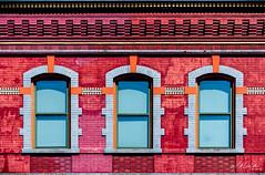 3 Windows (MTR70) Tags: windows window brick bricks facades facade masonry building blue orange red architecture symmetry symmetrical old